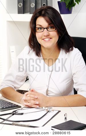 Young and attractive woman doctor in her office