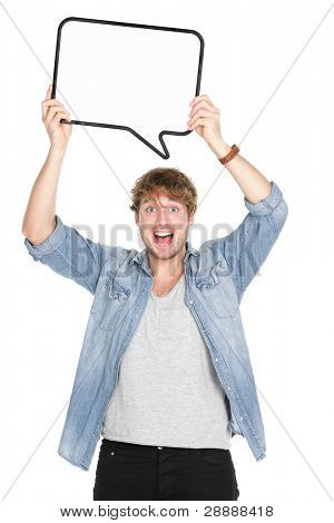 Man holding sign speech bubble screaming excited. Young casual caucasian man in his twenties. Isolated on white background.