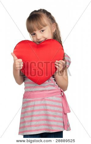 Portrait of little girl holding red heart and giving you thumb up over white background