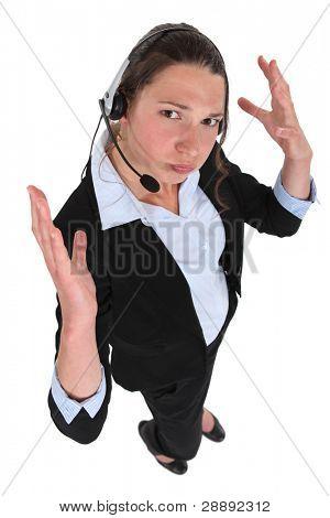 receptionist with earphones looking exasperated