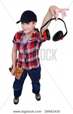 Female construction worker showing headphones
