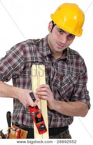 craftsman rasping a board