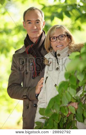 senior couple walking in the forest
