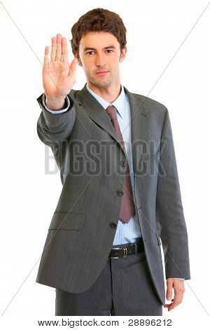 Serious Modern Businessman Showing Stop Gesture