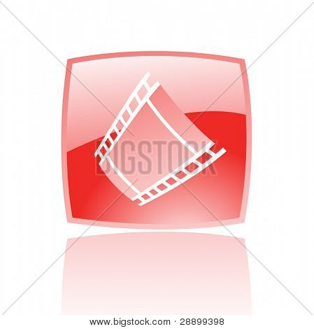 Red film reel in red glass button isolated on white