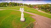 6768_the_estonian_mother_monument_in_front_of_a_building.jpg poster