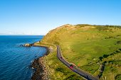 Northern Ireland, Uk. Causeway Coastal Route A.k.a Antrim Coast Road Near Ballygalley Head And Resor poster