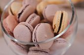 Colorful Macarons Stand In Round Transparent Weight As Part Of Candy Bar Sweet Table poster