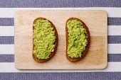 Sandwich With Guacamole On Light Textile Background Top View Sandwiches On Wooden Board poster