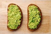 Sandwich With Guacamole Top View. Sandwiches On Wooden Board poster