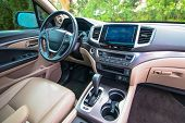 The Interior Of A Luxury Suv Truck For Sale poster