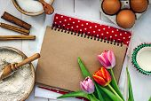 Background With Festive Pastry Baking Ingredients. Notebook With Brown Sheets For Writing A Recipe,  poster