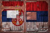 Close-up Of Old Warehouse Gate With National Flag Of Serbia. The Concept Of Export-import Serbia, St poster