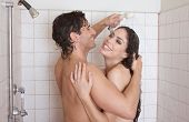 stock photo of early 20s  - Loving affectionate nude young heterosexual couple in affectionate sensual kiss after taking shower - JPG