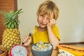 Boy Eats Fruit. Healthy Food For Children. Child Eating Healthy Snack. Vegetarian Nutrition For Kids poster