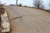 Large Cracks, Chips, Plates. Broken Asphalt Shifted Landslide After An Earthquake. Dangerous Deep Cr poster