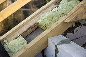 Roof Construction And Insulation With Mineral Wool. Wooden Beams Frame On Walls Of Hollow Foam Insul poster