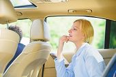 Business Woman Sit On Backseat. Busy Lady Passenger Leather Car Salon Enjoy Journey With Chauffeur.  poster