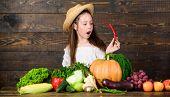 Child Celebrate Harvesting. Girl Kid Farm Market With Fall Harvest. Kid Farmer With Harvest Wooden B poster