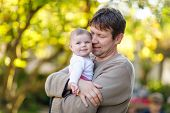 Happy Proud Young Father Having Fun With Newborn Baby Daughter, Family Portrait Togehter. Dad With B poster