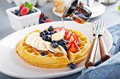 Waffle With Fresh Banana And Berries For Breakfast poster