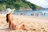 Woman Relaxing On The Beach Of The Sea And Happy Lifestyle. The Happy Woman Enjoys Of The Tropical S poster