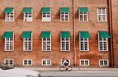 City With Brick Houses And Cyclists Driving On Historical Streets Of Copenhagen, Denmark. One Of The poster