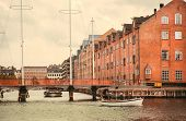 River Boat And Cityscape With Old Buildings Over Water In Copenhagen, Denmark. Danish Capital With O poster