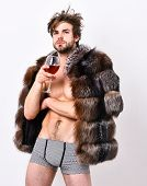 Rich Athlete Enjoy His Life. Sexy Sleepy Rich Macho Tousled Hair Drink Wine Isolated On White. Fashi poster