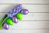 Beautiful Easter Background In Purple Color. Colored Purple Easter Eggs And Flowers Tulips In Purple poster