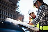 Construction Engineers Discussion With Consultant At Construction Site Or Building Site Of Highrise  poster