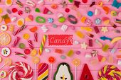 Many Candies And Lollipops On Color Background. Flat Lay Multicolored Candies And Sweets On Pink Woo poster