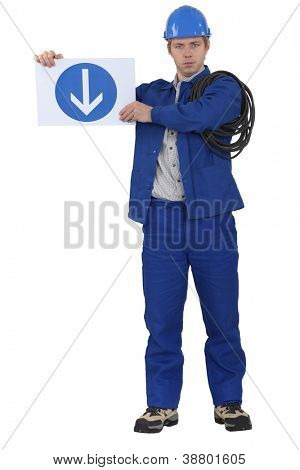 Tradesman holding a traffic sign