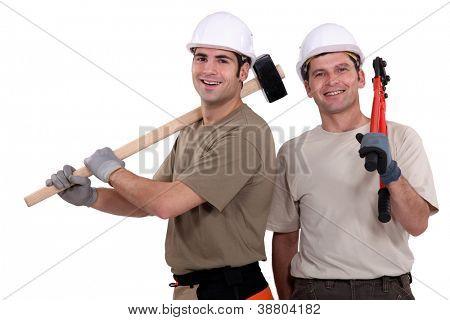 Two builder friends stood together