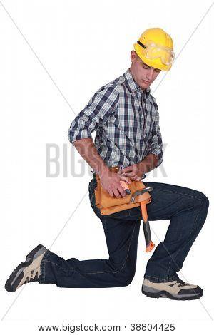 handyman kneeling