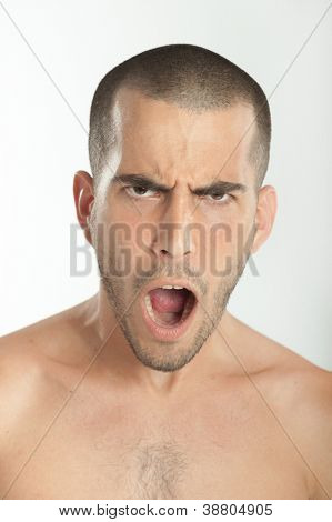 Portrait of a young man unhappily surprised