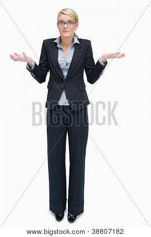 Businesswoman in glasses giving I don't know gesture