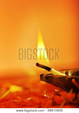 Close up of aflame of an indian lamp
