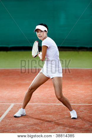 Tennis tournament. Female player at the clay tennis court