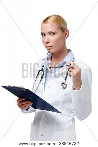 Female doctor writes in her notebook, isolated on white