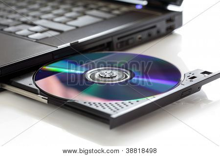 Inserting a blank CD or DVD into a laptop computer