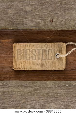 price tag over wooden background