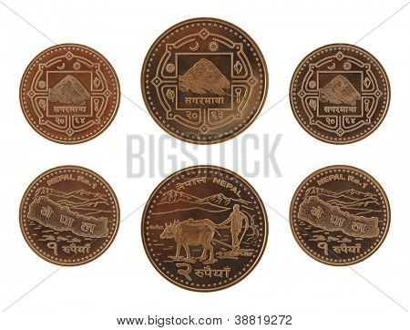 New Nepalese rupee coins depicting Mont Everest and the map of Nepal. Obverse and reverse isolated on white.