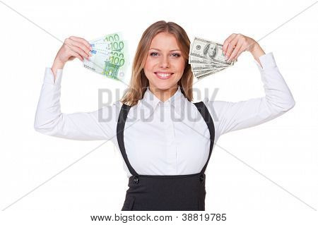 excited businesswoman holding paper money and smiling. studio shot over white background