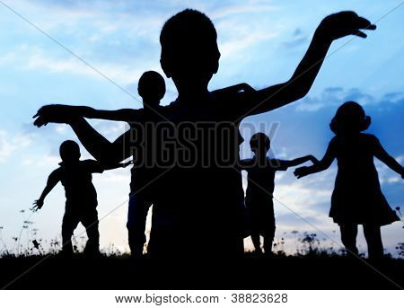 Running group of children silhouettes