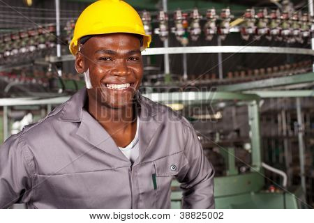 african american industrial worker portrait in front of machine
