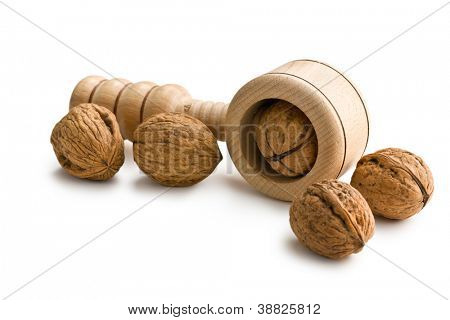 wooden nutcracker and walnuts on white background