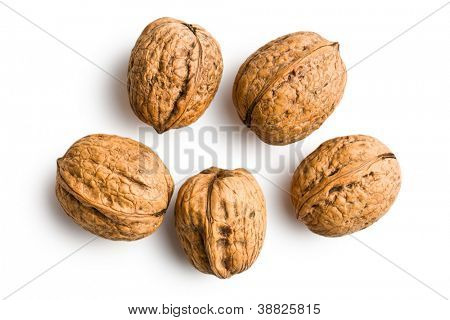 dried walnuts on white background