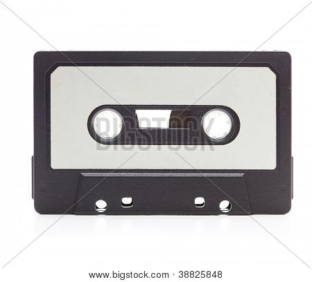 Early 70's cassette tape isolated on white with slight reflection. White blank label.