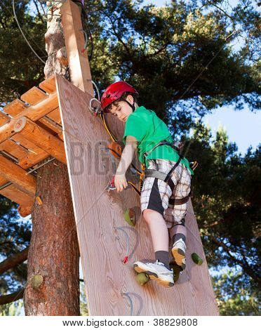 Boy climbing in adventure park